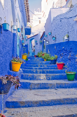 Deurstickers Small narrow blue streets with colorful pots line, Chefchaouen or Chaouen, Morocco