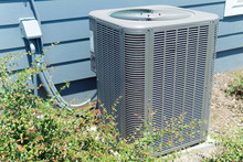 A/C Unit Connected To Residential House