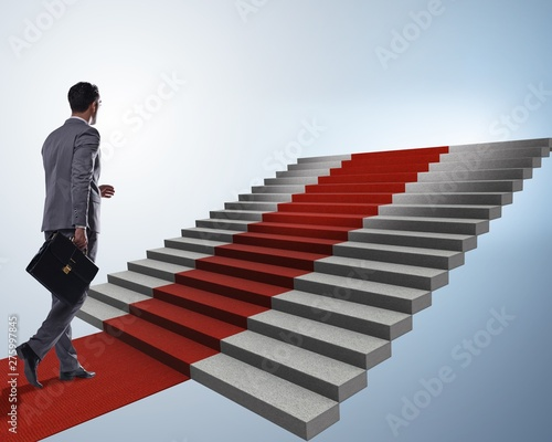 Fotobehang Hoogte schaal Young businessman climbing stairs and red carpet
