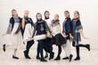 Group of beautiful girls in design costumes shot