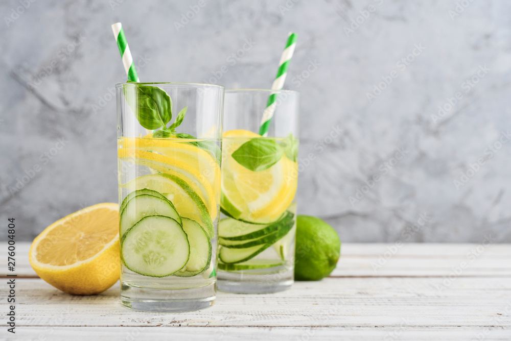 Fototapeta Infused water with cucumber, lemon, lime and basil