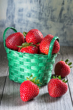 Strawberries In Green Basket