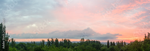 Canvas Prints Light pink Landscape with dramatic light - beautiful golden sunset with saturated sky and clouds.