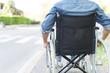 Leinwandbild Motiv Man using his wheelchair in a city