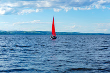 Sailboat With Scarlet Sails In...