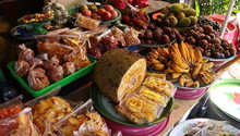 Asian Market With A Variety Of Exotic Fruits. Papaya, Bread Fruit, Banana.