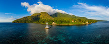 Aerial Panorama Of The Sunken Cemetery And Background Volcanos In The Evening Light On Camiguin Island, Philippines