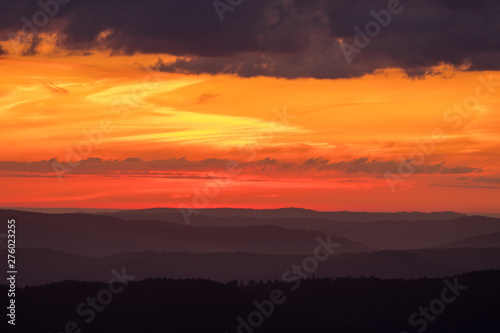 Poster Fleur Orange sky, clouds and mountains. Beautiful sunrise in the Bieszczady mountains. Poland
