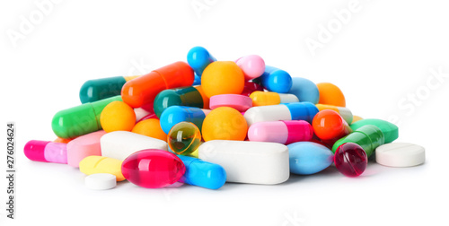 Stampa su Tela  Pile of pills on white background. Medical treatment