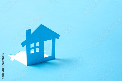 Fotografering Concept of house in paper on blue color background for real estate property indu