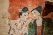 The Famous Mural Painting Of A Man Whispering To The Ear Of A Woman.