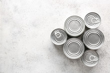 Tin Cans With Food On Grey Bac...