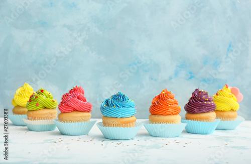 Sweet tasty cupcakes on light table Canvas Print