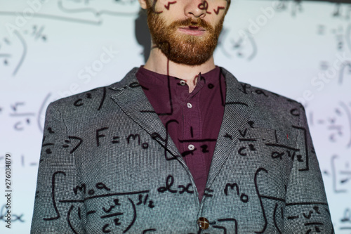 Wallpaper Mural Bearded man in gray jacket standing against projection screen displaying mathema