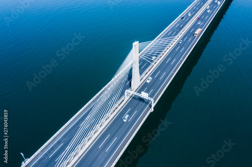 Aerial view of bridge road and cars
