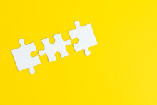 3 Jigsaw Puzzle On Solid Yello...