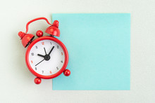 Flat Lay Of Red Alarm Clock With Blank Sticky Note For Message On White Background With Copy Space Using As Time, Deadline, Stop Procrastination Or Schedule Presentation Wallpaper