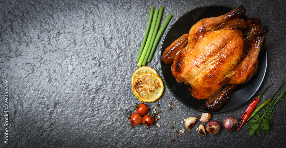Fototapety, obrazy: Roasted chicken / baked whole chicken grilled with herbs and spices and dark background