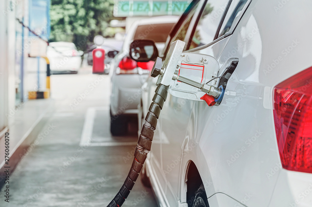Fototapety, obrazy: Fuel up the natural gas vehicle (NGV) at the station.