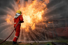 Firefighters Spraying Water In Fire Fighting Operation, Fire And Rescue Training School Regularly To Get Ready