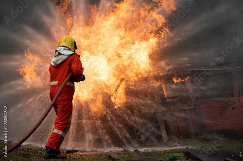 Canvastavla  firefighters spraying water in fire fighting operation, Fire and rescue training