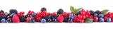 Tasty berries, currants, blackberries, blueberries, raspberries on a white isolated background