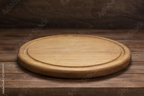 pizza cutting board at rustic wooden table in front Wallpaper Mural