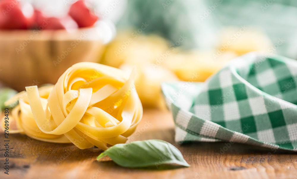Fototapety, obrazy: Italian pasta tagliatelle on table with basil and tomatoes
