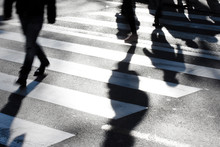 Blurry Zebra Crossing With Pedestrians Making Long Shadows