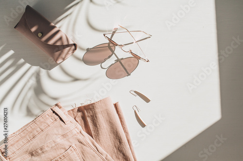 Canvas Prints Countryside Fashion composition with women's clothes and accessories on white background. Earrings, sunglasses, pink jean culottes on white background. Flat lay, top view lifestyle blog concept.