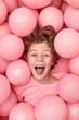 Leinwandbild Motiv Excited kid playing in balloons