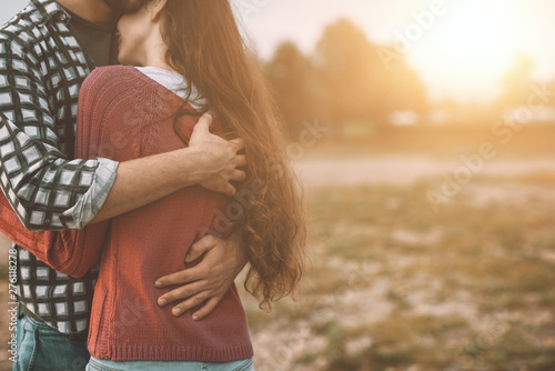 Tablou Canvas Young loving couple hugging outdoors