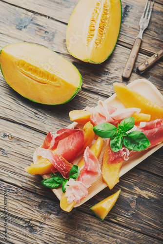 Poster Amsterdam Italian antipasto with melon and ham