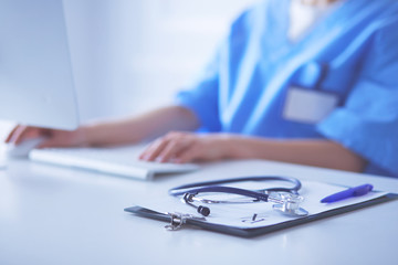 Stethoscope on desk. Doctor working in hospital. Healthcare and medical concept
