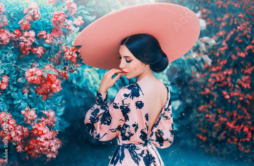 Cuadros en Lienzo  cute woman with perfect gentle hairdo from long black hair wearing pink hat with