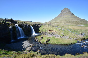 Famous kirkjufell mountain with the kirkjufell falls waterfalls in front in Grundarfjödur in Iceland