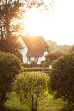 Sunset Scenery Of Typical Frisian House With A Thatched Roof And White Facade On Sylt, Germany