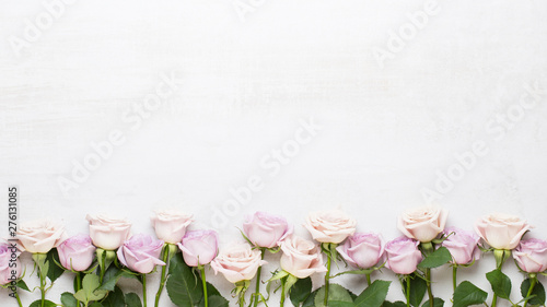 Flowers composition. Frame made of pink rose on gray background. Flat lay, top view, copy space. - 276131085