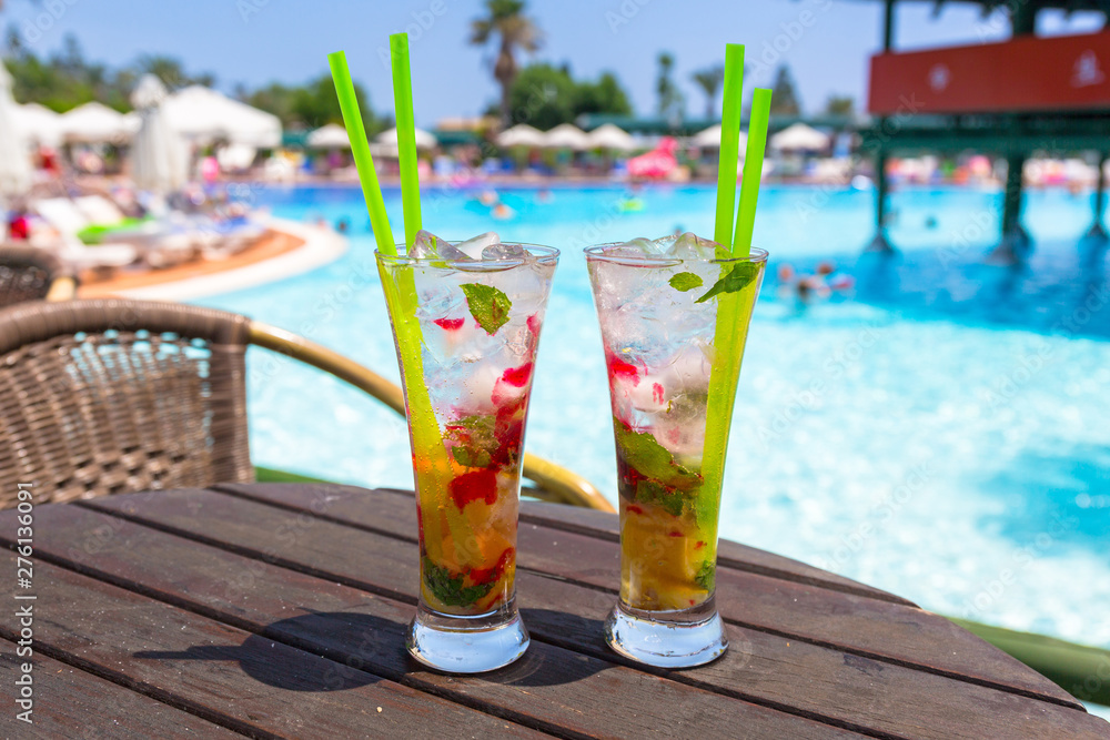 Fototapety, obrazy: Cocktail glasses at the pool on summer holidays