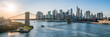 New York City skyline panorama at sunset with Brooklyn Bridge