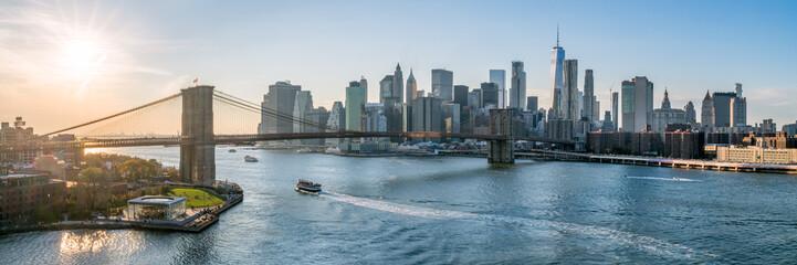 New York City skyline panorama at sunset with Brooklyn Bridge