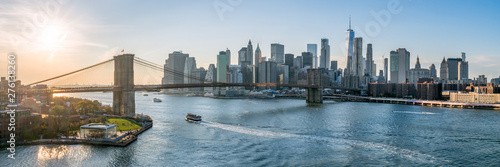 Wall Murals New York New York City skyline panorama at sunset with Brooklyn Bridge