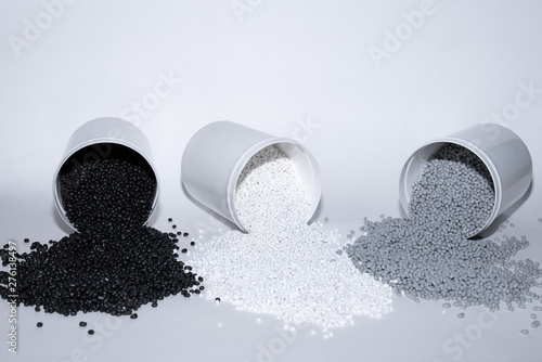 Photo Glass with termoplastic elastomer granules on a white background