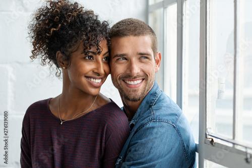 Photo Loving multiethnic couple thinking