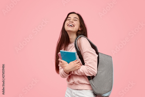 Carta da parati  Excited student laughing and hugging notebooks
