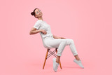 Relaxed teen girl sitting on chair