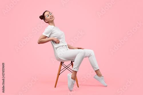 Fényképezés Relaxed teen girl sitting on chair