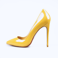 Female Yellow Shoes On White Background