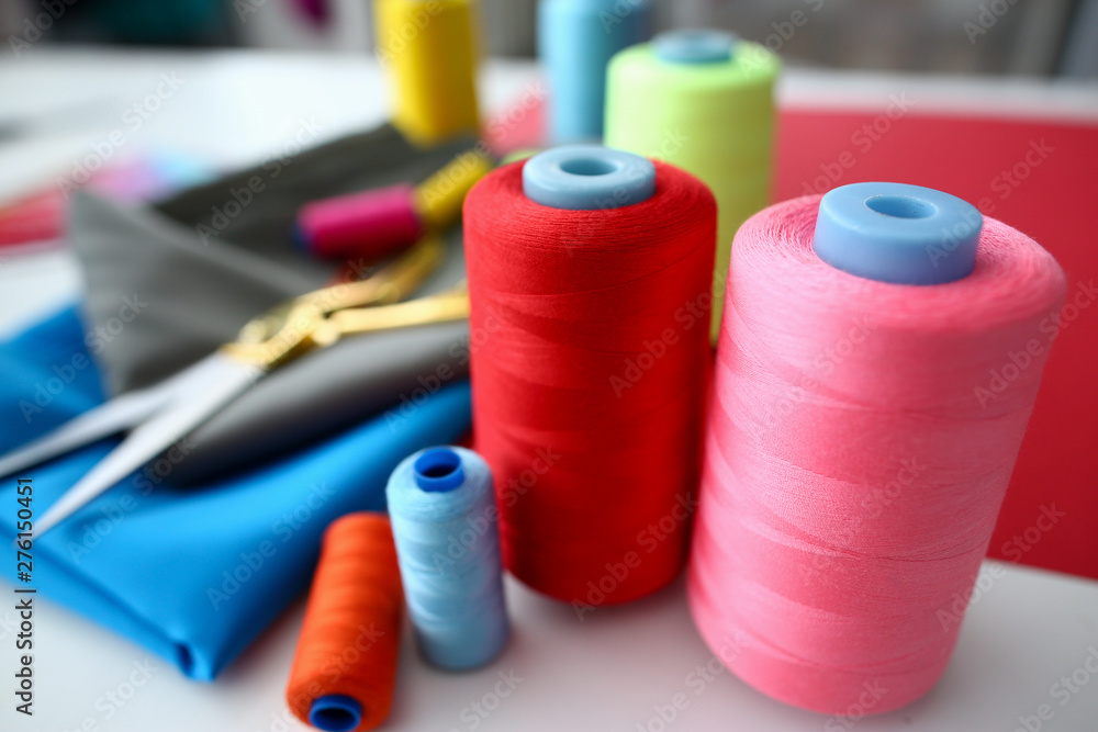 Fototapety, obrazy: Clothes Design Process Tailor Craftsman Equipment. Fabric and Sewing Tools on Table. Machine Bobbins and Spools of Color Thread with Scissors on Silky Material. Designer Dress Creating Accessories