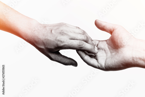Fotografie, Obraz  Emotional, black and white photo of two hands at the moment of farewell
